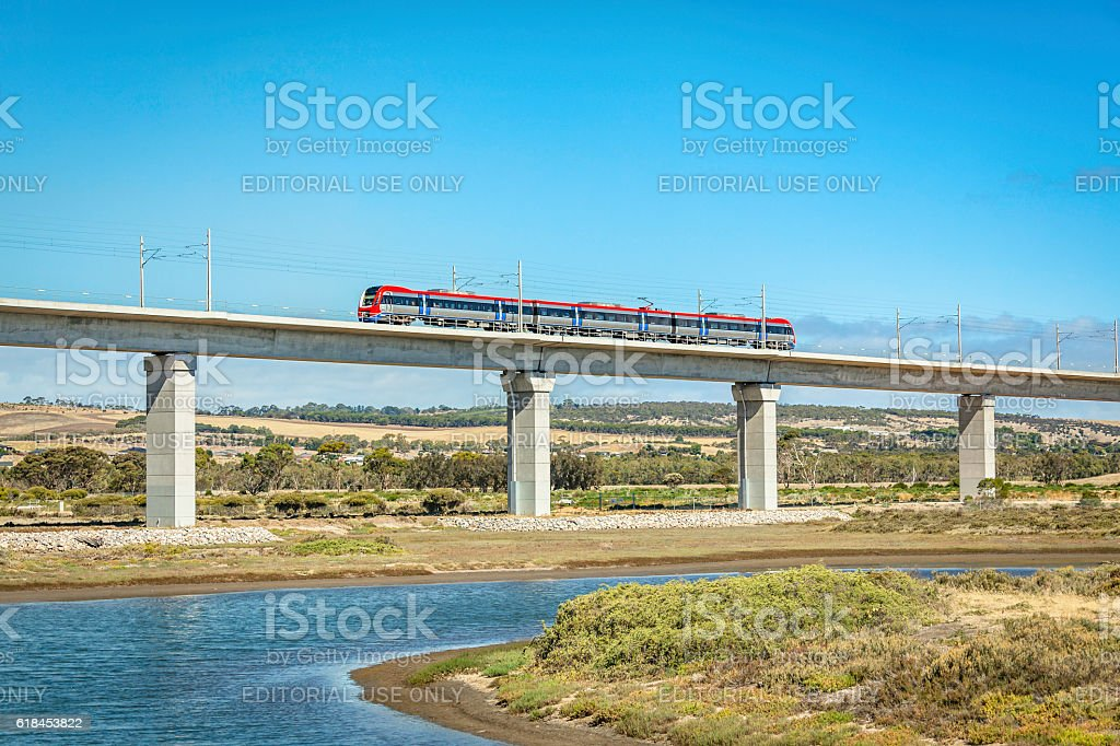 Side-view Adelaide Metro train crossing impressive Onkaparinga River rail-bridge stock photo