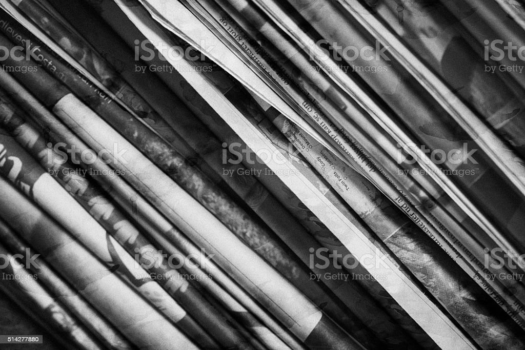 Sideview of a stack of newspapers stock photo