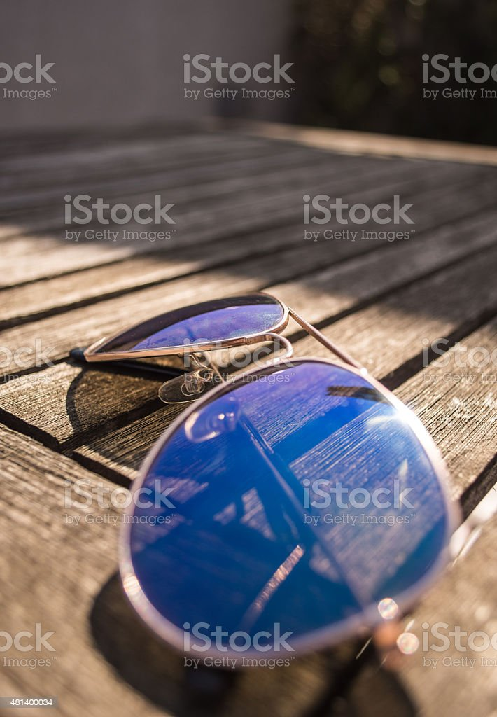 Side-view of Aviator Sunglasses on a Table royalty-free stock photo
