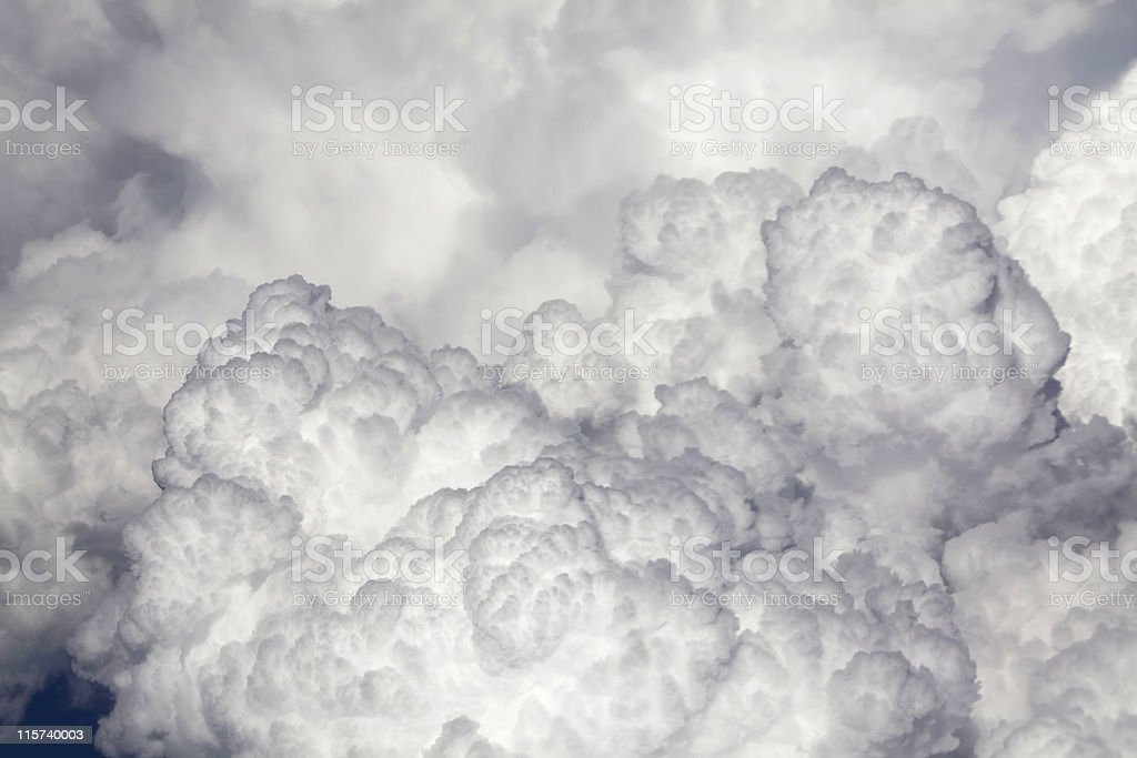 Sideview of human face portayed by clouds stock photo