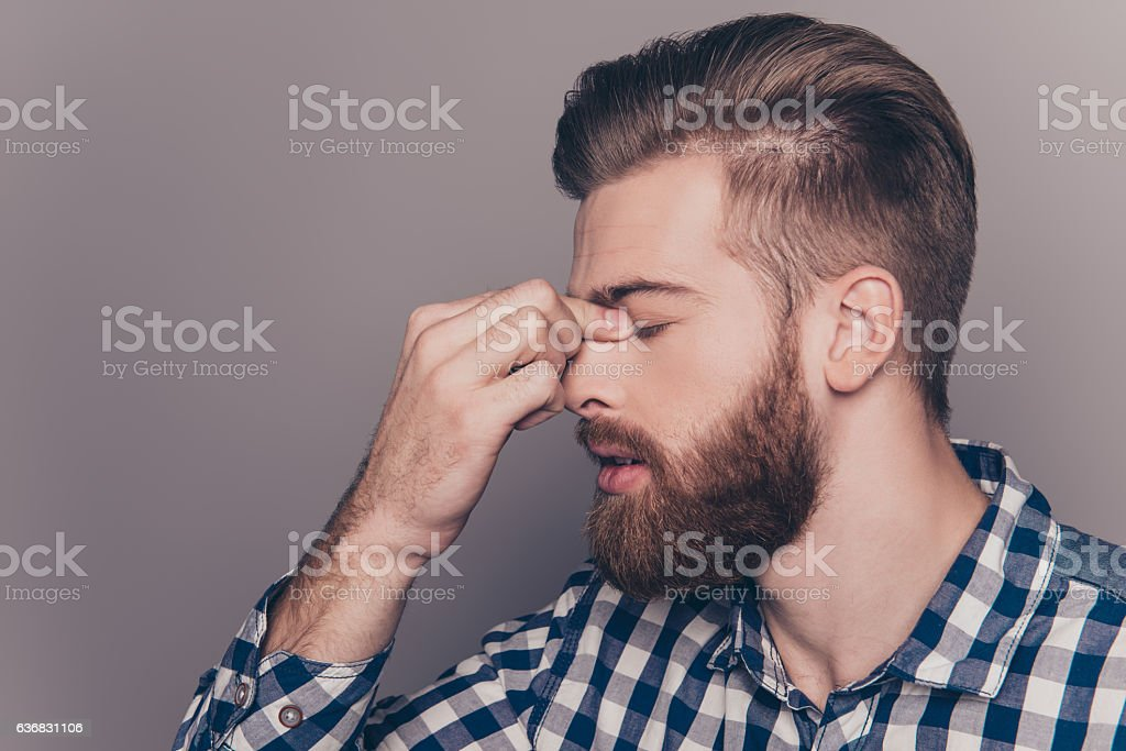 side-view of tired sick handsome young man with strong migraine stock photo