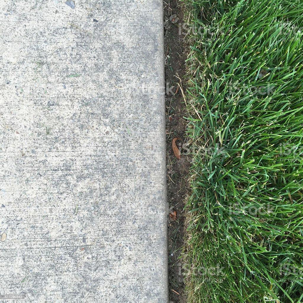 Sidewalk and Neatly Edged Grass stock photo