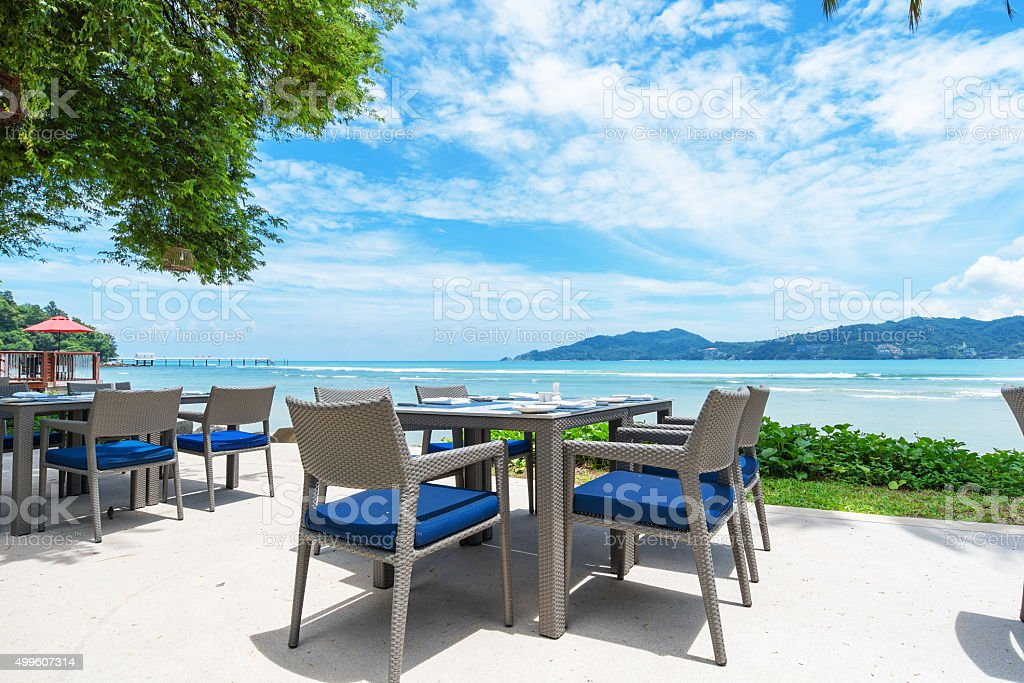 Sidewalk cafe near the tropical sea stock photo