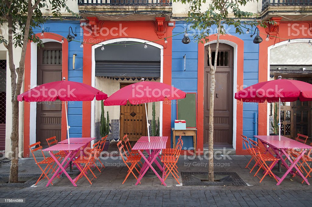 Sidewalk cafe with outside seating area with pink tables stock photo