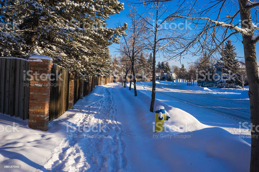 Sidewalk covered with fresh snow stock photo