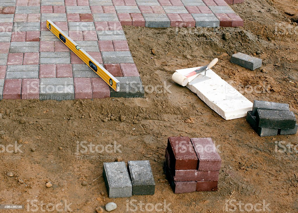 sidewalk tiles and tools for laying paving slabs stock photo