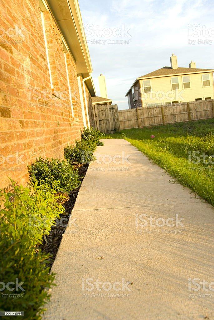 Sidewalk to Home stock photo