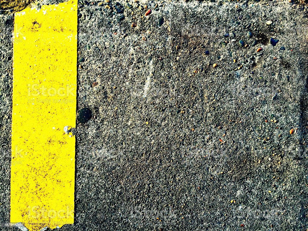 Sidewalk with yellow painted stripe royalty-free stock photo