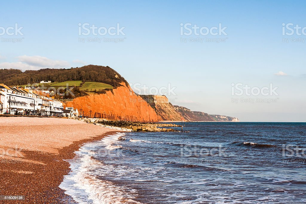 Sidmouth esplanade pebble beach and sandstone cliffs in Devon, England stock photo
