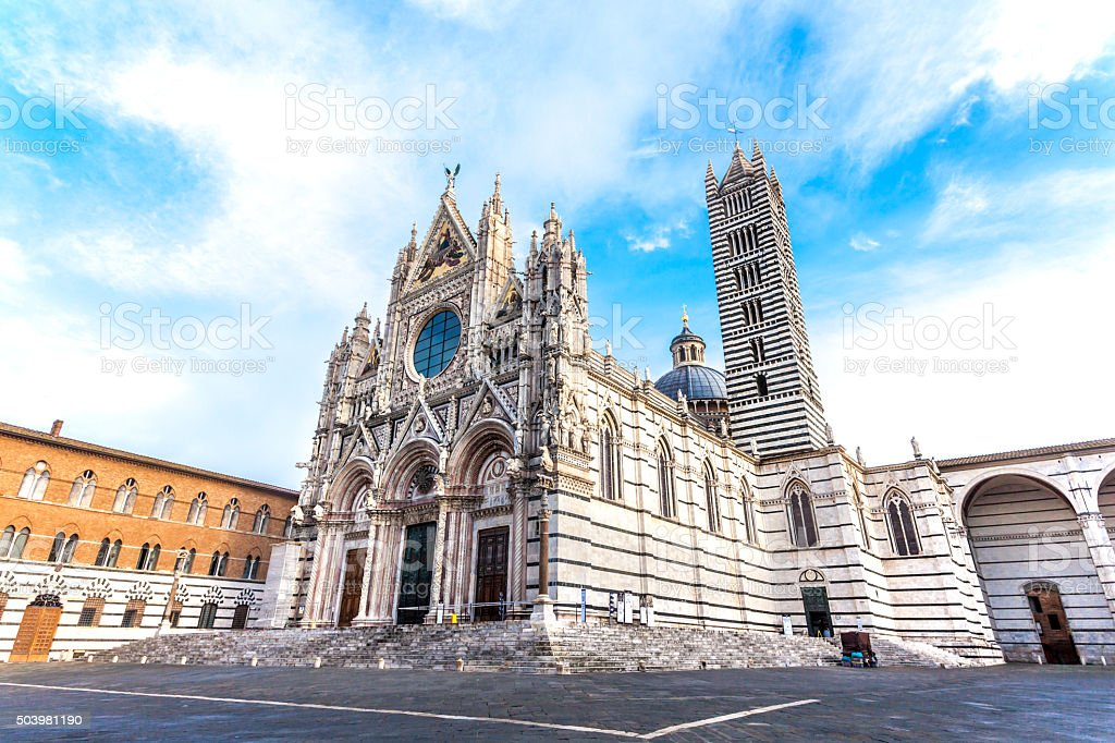 Siena cathedral against a bright blue sky in Italy stock photo
