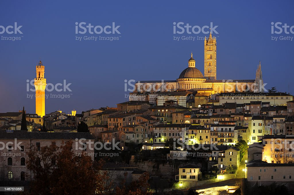 Siena Cathedral, Palazzo Pubblico and cityscape after sunset, Tuscany italy stock photo