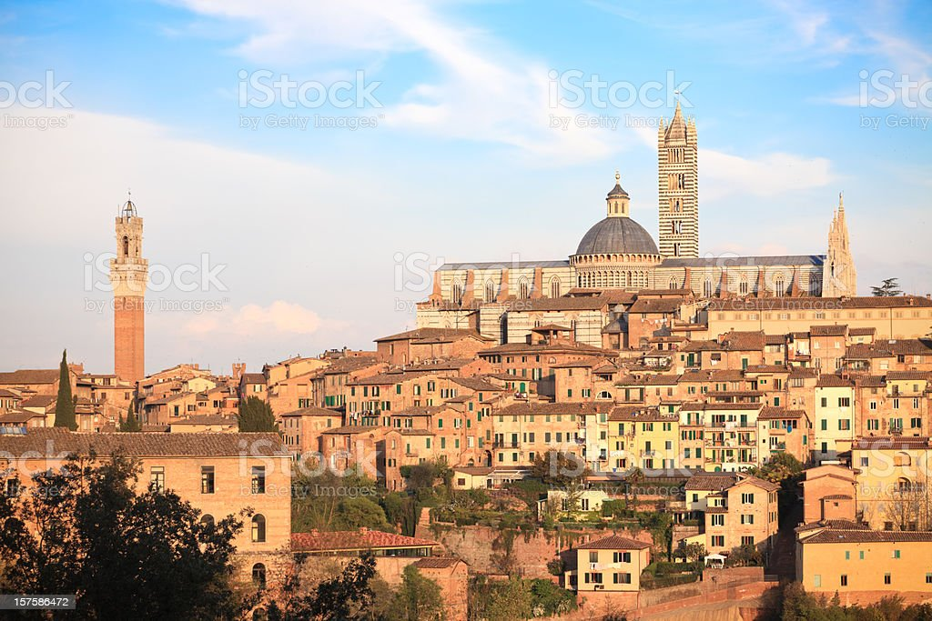 Siena Cathedral, Palazzo Pubblico and cityscape at sunset, Tuscany Italy stock photo