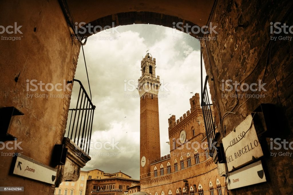 Siena City Hall Bell Tower archway stock photo