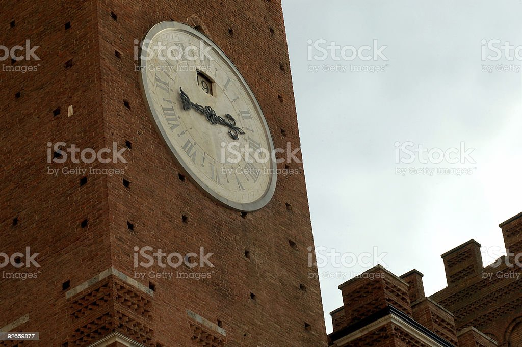 Siena clock tower stock photo