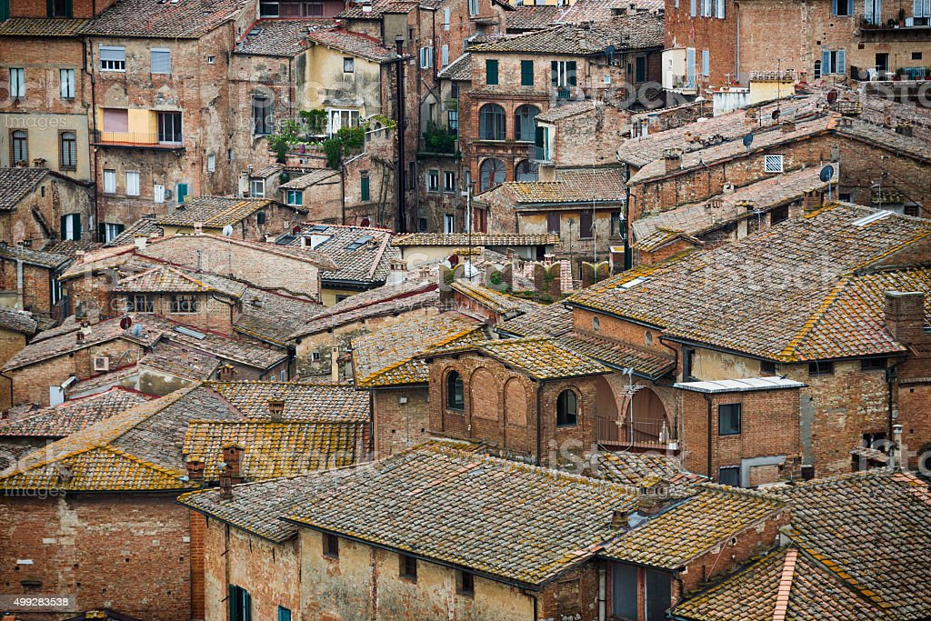 Siena colored roofs and walls stock photo