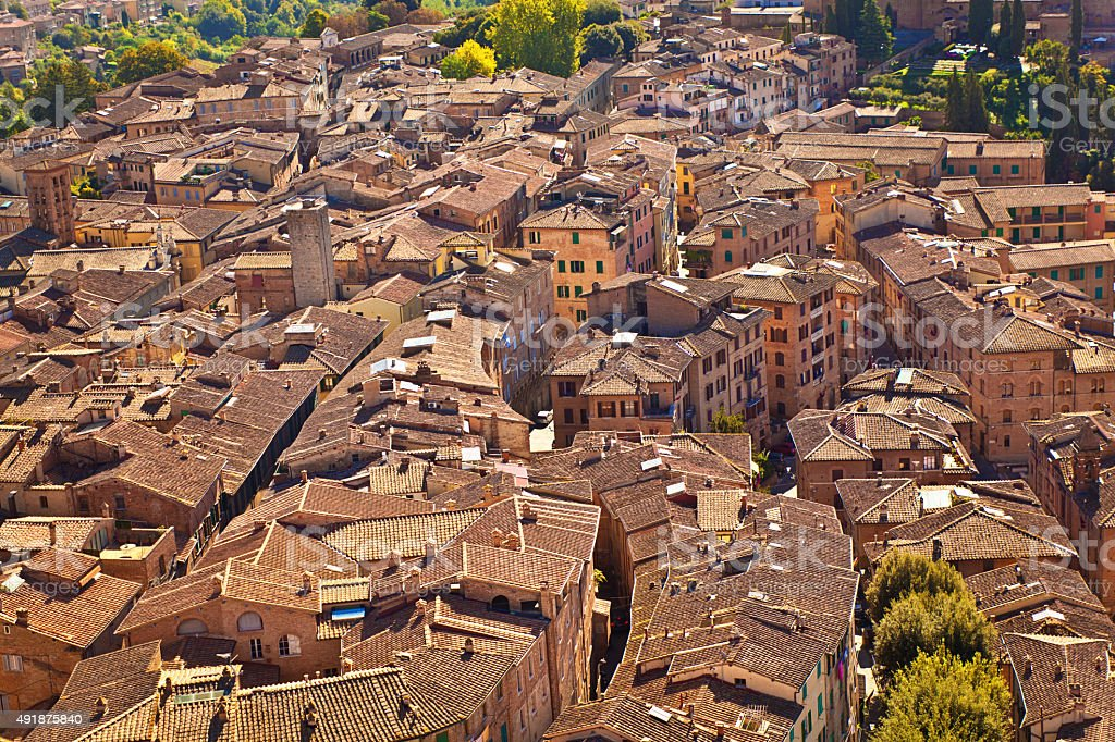 Siena Hilltown Buildings and Rooftops Tuscan Picturesque Cityscape, Tuscany, Italy stock photo