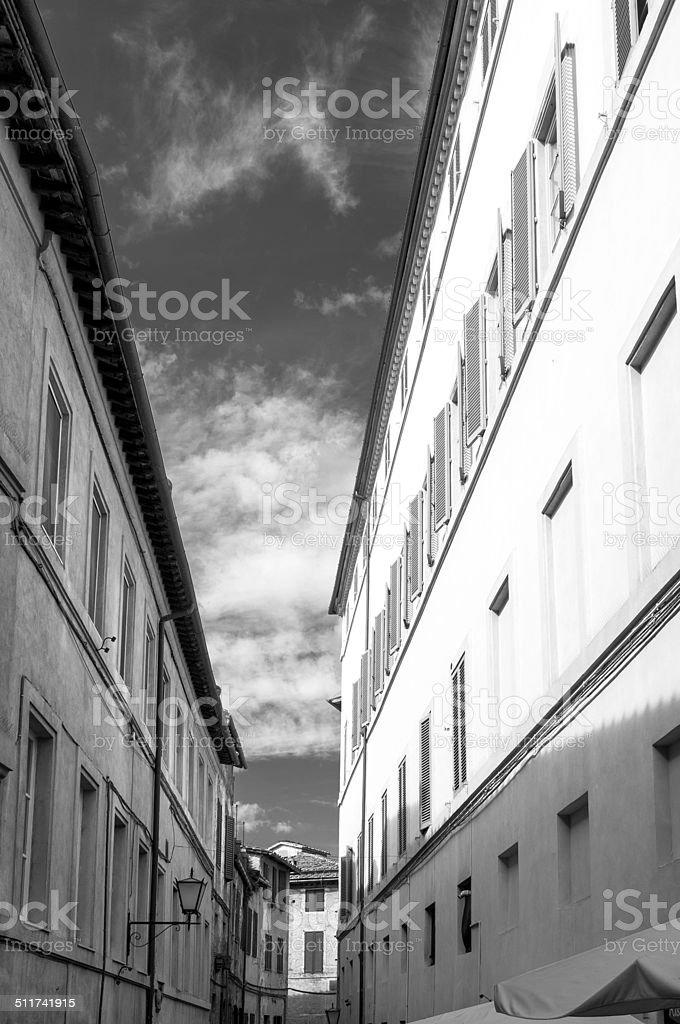 Siena, old alley. BW image stock photo