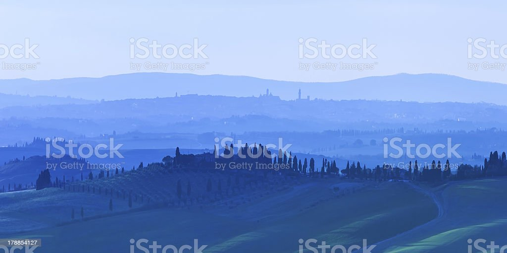 Siena, rolling hills on blue sunset. Rural landscape. Tuscany, Italy royalty-free stock photo