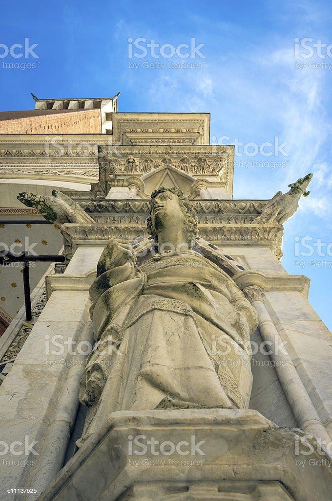 Siena, statue of the Cappella di Piazza. Color image stock photo