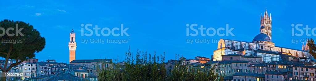 Siena Tuscany blue dusk Torre del Mangia Duomo panorama Italy royalty-free stock photo