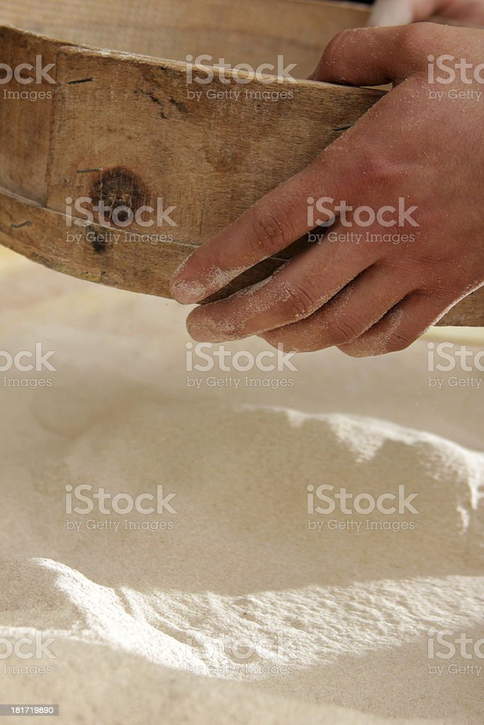 Sifting flour royalty-free stock photo