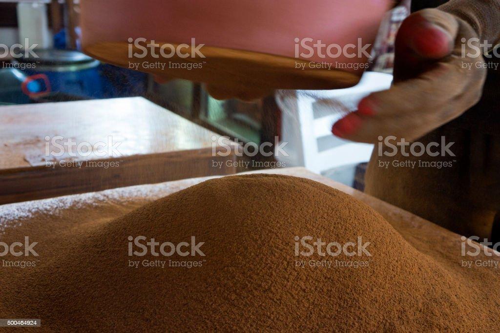 Sifting Flour stock photo