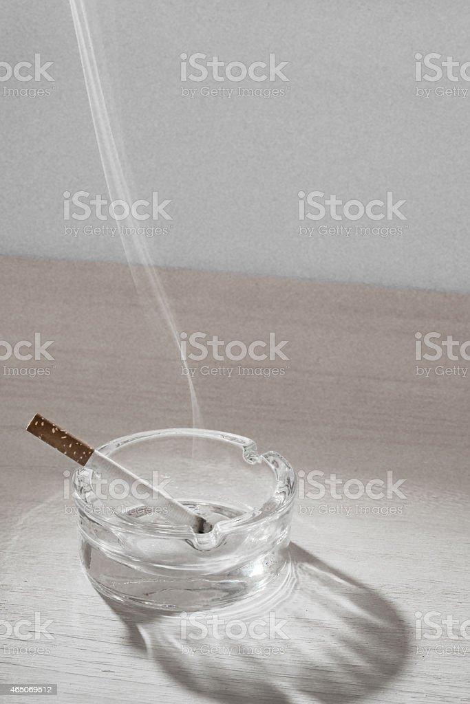 Sigarette in Ashtray stock photo