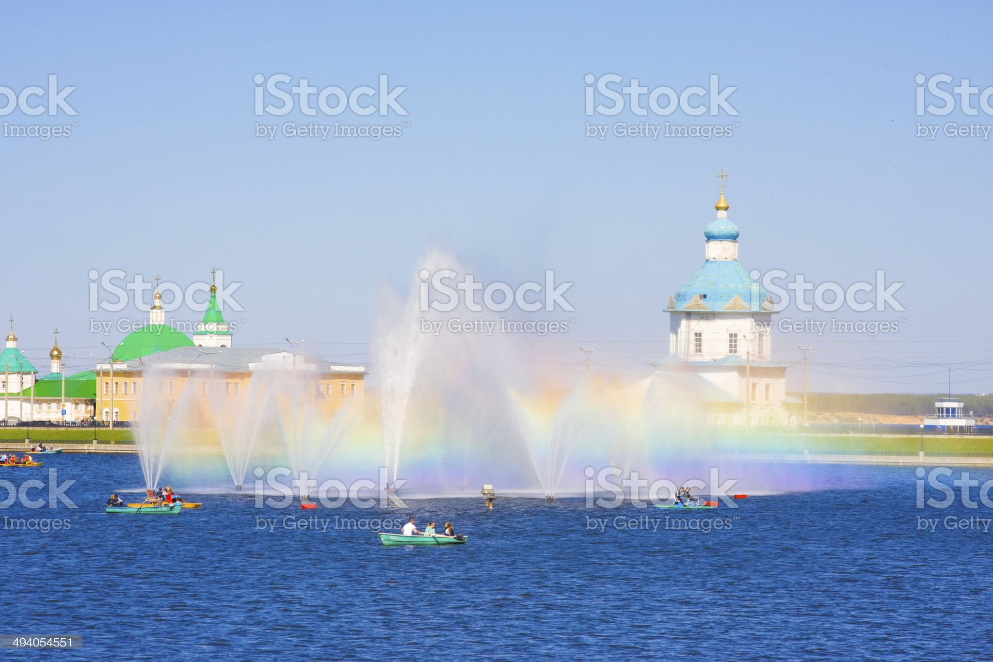 Sight of Cheboksary. Rainbow and fountains on background of monastery. Russia royalty-free stock photo