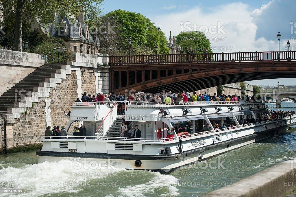 Sightseeing Boat on Seine Near Ile de la Cite, Paris stock photo