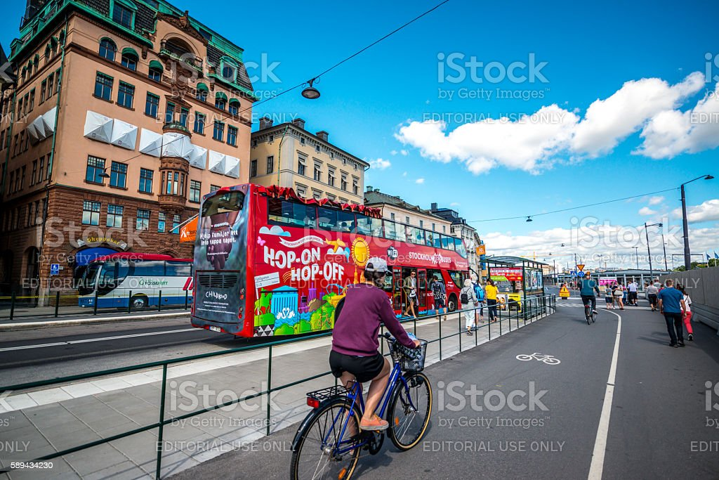 Sightseeing bus with tourists in Gamla Stan, Stockholm stock photo