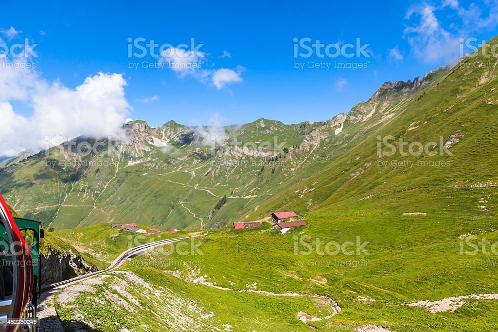 Sightseeing by the steam train in swiss alps stock photo