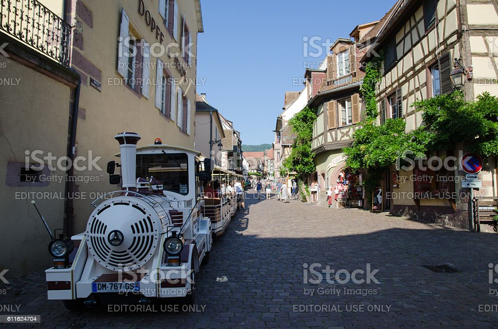 Sightseeing train in the village Riquewihr in France stock photo