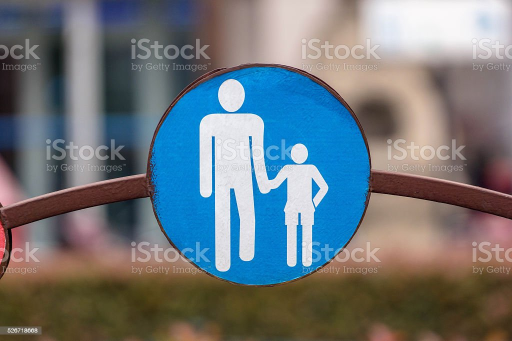 sign: adult and child hand in hand crossing road stock photo
