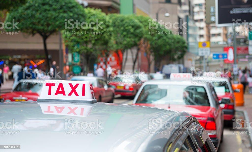 TAXI sign and Hong Kong stock photo