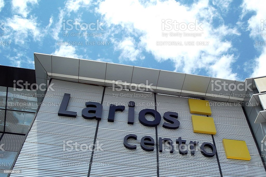Sign and Logo of Larios Centro in Malaga, Spain stock photo