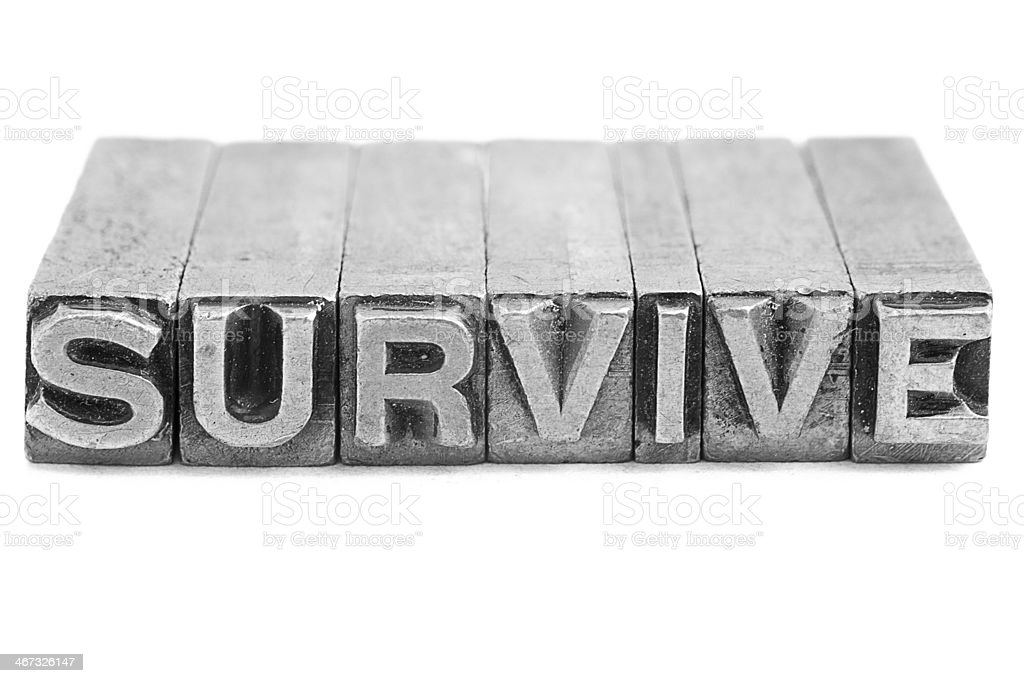 SURVIVE sign, antique metal letter type royalty-free stock photo