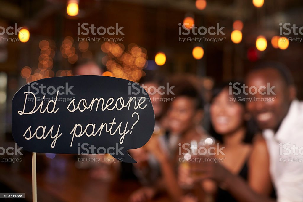 Sign at a party, defocussed celebrations in the background stock photo