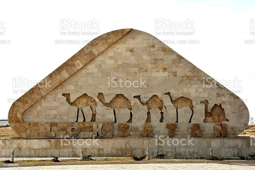 Sign at entry to Lokbatan, with camels stock photo