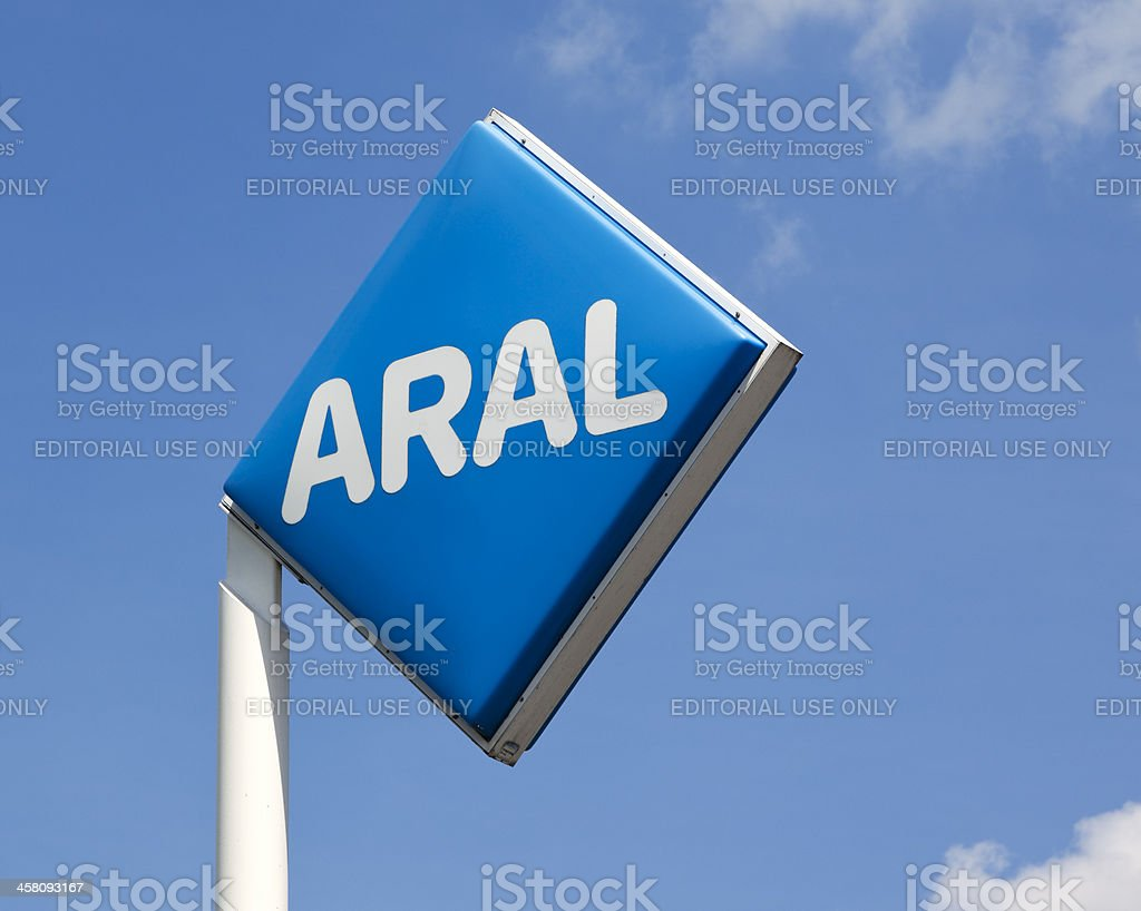 ARAL sign at gas station against blue sky stock photo
