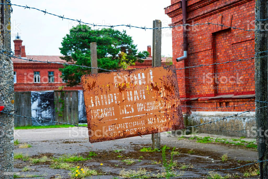 Sign board with warning on russian at prison entrance stock photo