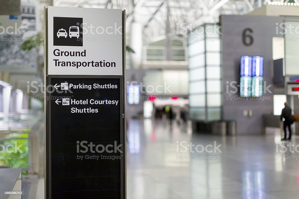 Sign directing airport arrivals to ground transportation stock photo