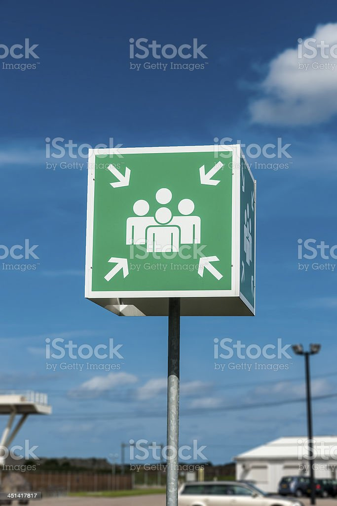 A sign directing people to the fire assembly point stock photo