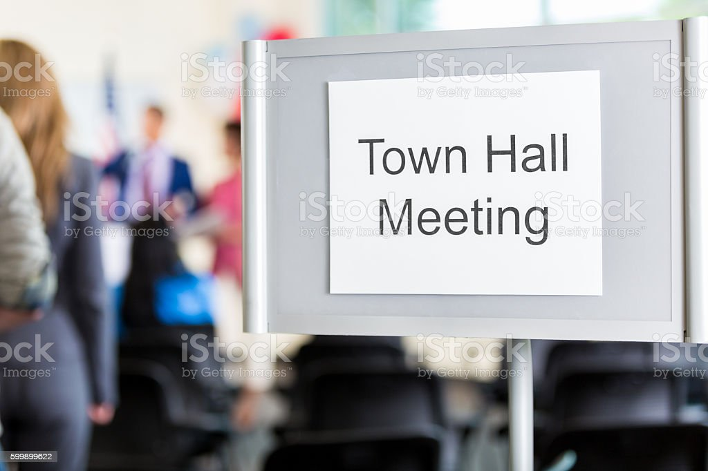 Sign directing public to town hall meeting stock photo
