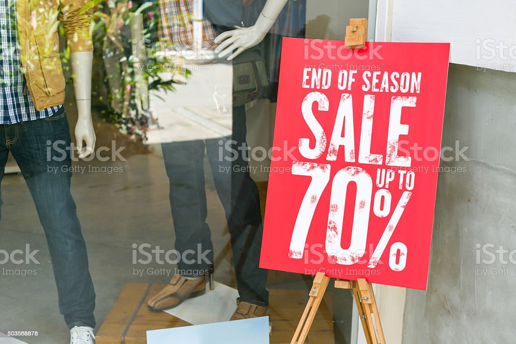 Sign discount knock out on shop store. stock photo