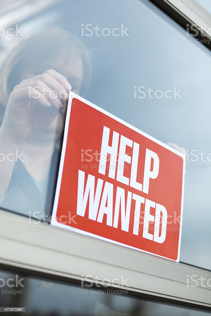 """HELP WANTED"" Sign Displayed for Recruitment, Hiring, Employment in Retail stock photo"