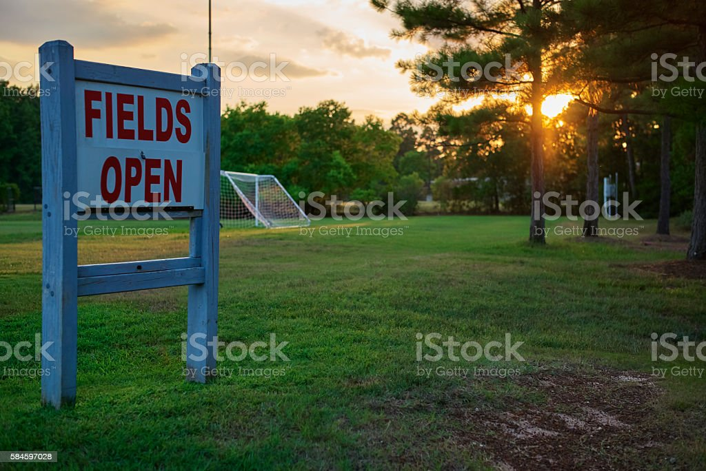 Sign Displaying Fields Open With Soccer Net In Background stock photo