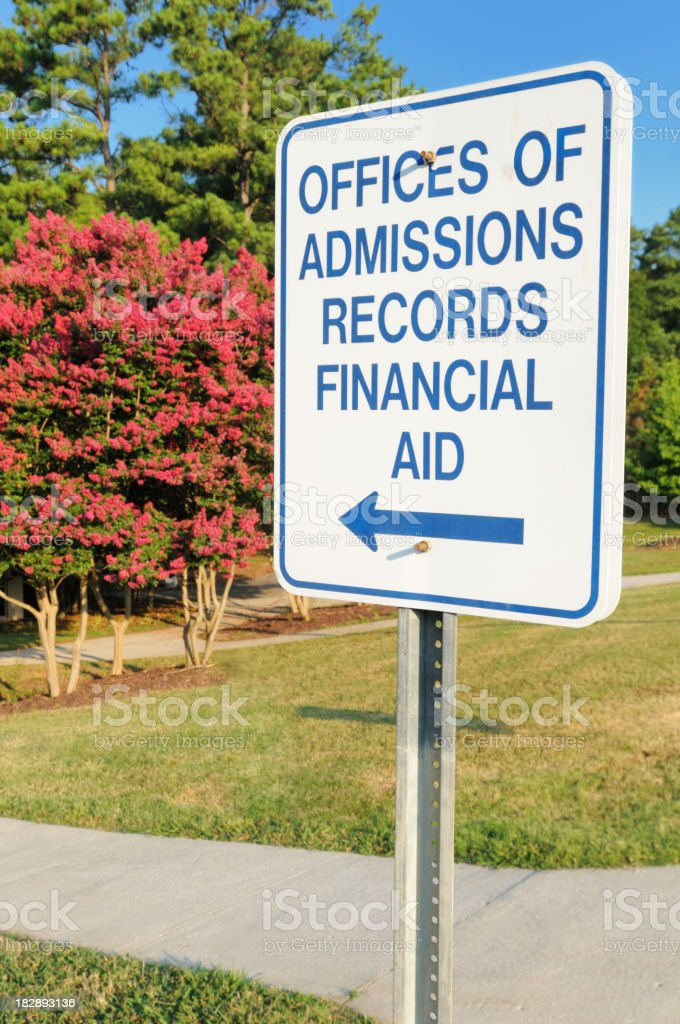 Sign for admissions records and financial aid on campus royalty-free stock photo
