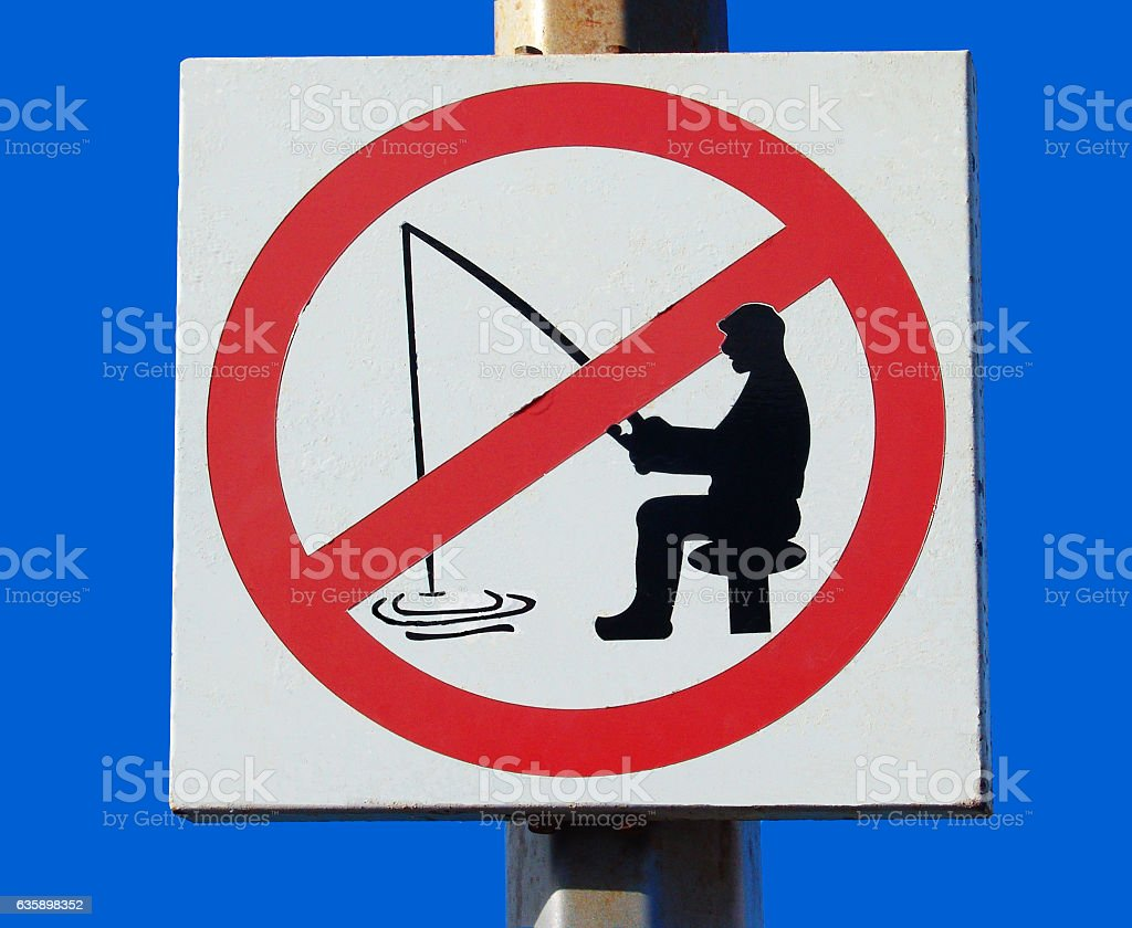 Sign Forbidden to fish in a port stock photo