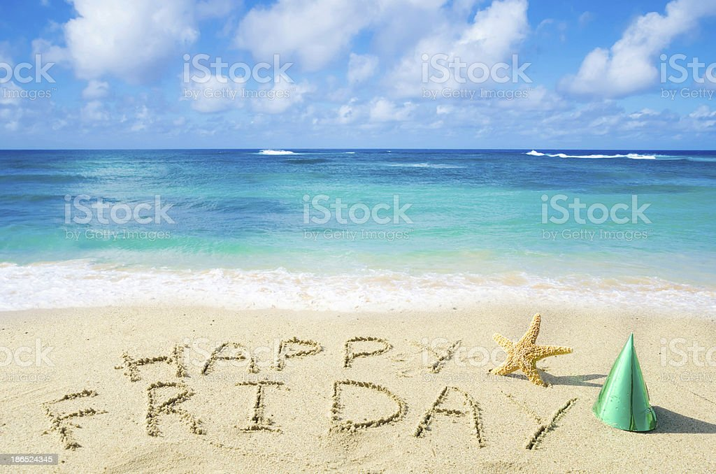 Sign 'Happy Friday' on the sandy beach stock photo