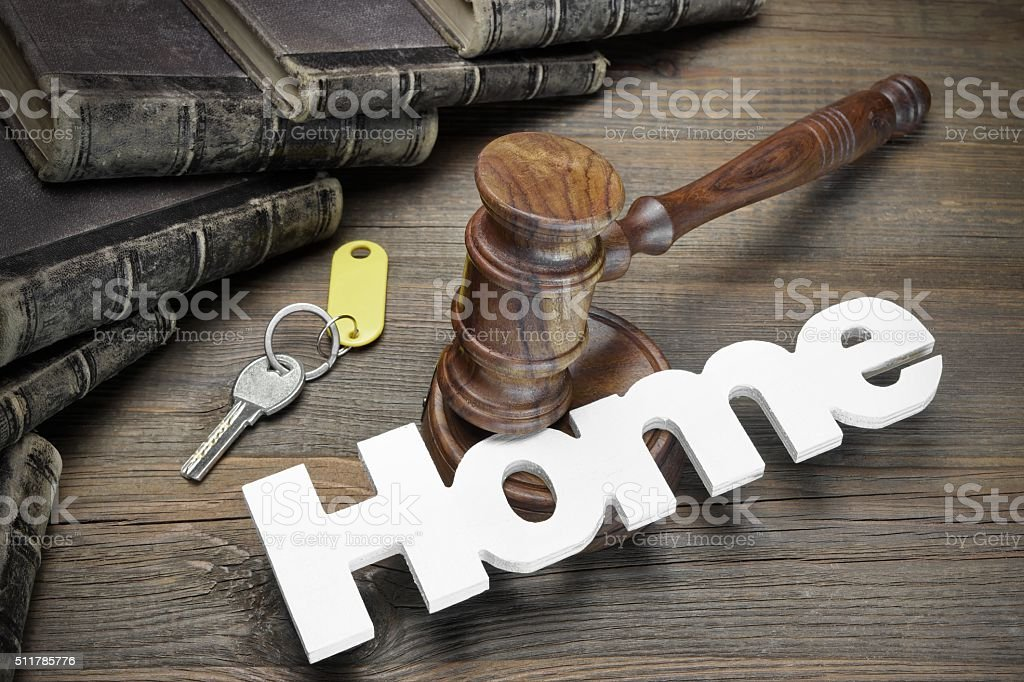 Sign Home, Key, Judges Gavel And Book On Wood Table stock photo